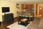 Mammoth Condo Rental Aspen Creek 117: Spacious Living Room with large smart TV, Dining Room with seating for 8