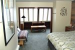 Mammoth Condo Rental Wildrose 9: Second bedroom from the entrance looking at queen bed, futon, and sunroom