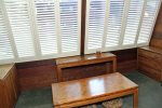 Mammoth Condo Rental Wildrose 9: Sunroom area with excellent light for puzzels and games. Screen door access to deck.