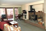 Mammoth Condo Rental Wildrose 9: Living room offers a flat screen TV and wood burning stove