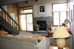 Mammoth Condo Rental Sunrise 3 - Living Room with Woodburning Stove and New Rock Hearth
