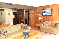 Mammoth Lakes Condo Rental Sunrise 6 - Comfortable Living Room Opens to Outside Deck