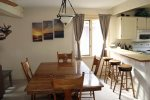 Mammoth Rental Sunrise 12 - Comfortable Dining Room with Seating at Table and Bar