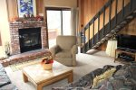 Mammoth Vacation Rental Sunrise 15 - Living Room with Woodstove and Access to Outdoor Deck