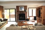 Mammoth Lakes Rental Sunrise 32 - Living Room with Woodstove and Access to Outdoor Deck