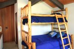 Mammoth Condo Rental Sunrise 35 - Loft with a Bunk Bed that has a Queen on the Bottom and Twin on Top