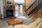 Mammoth Vacation Rental Sunrise 35 - Comfortable Living Room with Woodburing Stove, Outside Deck, Loft Stairs