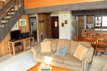 Mammoth Lakes Vacation Rental Sunrise 35 - Open Floor Plan Living Room with Flat Screen TV, Condo Entrance