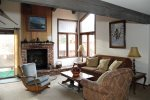 Mammoth Vacation Rental Sunrise 37- Spacious Living Room with Woodburing Stove