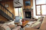 Mammoth Vacation Rental Sunrise 37- Living Room with Access to Outside Deck and Stairs to the Loft