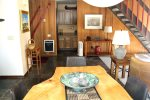 Mammoth Lakes Vacation Rental Sunrise 43 - Dining Room Table looking to Entry and Hall to Master Bedroom