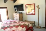 Mammoth Condo Rental Sunrise 43- Master Bedroom has a large window and a Flat Screen TV