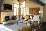Mammoth Lakes Rental Sunrise 43 - Living Room has a Woodburning Stove and Large Flat Screen TV