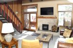 Mammoth Condo Rental Sunrise 43- Beautiful Living Room with Stairs to the Loft and Deck with Partial Views