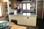 Mammoth Lakes Rental Sunrise 43 - Dining Table and Kitchen with Granite Counters
