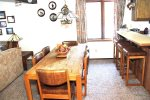 Mammoth Lakes Vacation Rental Sunrise 46 - Dining Room with 6 Chairs and 4 Bar Stools at Bar