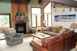 Mammoth Condo Rental Sunrise 47 - Well furnished living room with woodburning stove