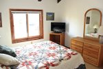 Mammoth Vacation Rental Sunrise 51 -  Bedroom with a Queen Bed and Flat Screen TV