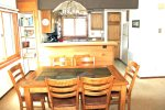 Mammoth Rental Sunrise 51 - Dining Table with 6 Chairs and 2 Bar Stools at Counter