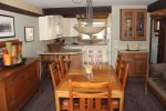 Mammoth Lakes Rental Woodlands 10- Dining Room seats 6 and is open to the Kichen