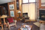 Mammoth Lakes Rental Woodlands 10- Living Room with Wood Burning Fire Place and Access to Deck