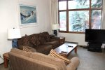Mammoth Lakes Condo Rental Woodlands 30-  Cozy Living Room with Large Window and Flat Screen TV