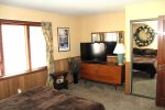 Mammoth Lakes Rental Woodlands 48 - Master Bedroom with Flat Screen TV and Large Closet