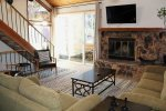 Mammoth Condo Rental Snowflower 5 - Living Room Large Flat Screen TV and Outside Deck Access