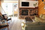 Mammoth Condo Rental Snowflower 5 - Living Room has a Wood Burning Fireplace