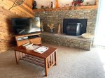 Mammoth Vacation Rental Snowflower 11- Living Room Stairs to Loft, Access to Outside Deck