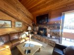 Mammoth Condo Rental Snowflower 37 - LR has Pellet Stove and Outside Deck Access