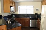 Mammoth Condo Rental Snowflower 37 - Dining Room and Kitchen with additional seating at the bar