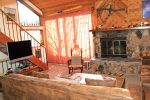 Snowflower 45 Mammoth Vacation Rental - Living Room with Flat Screen TV, Outside Deck, Wood Stove