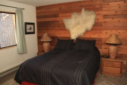 Mammoth Lakes Vacation Rental Snowflower 45 - Master Bedroom from Another View with a Walk-in Closet and En-suite Bathroom