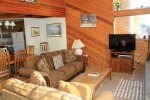 Mammoth Lakes Condo Rental Snowflower 82 - Living Room TV and Woodstove