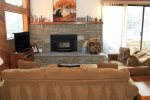 Mammoth Lakes Rental Snowflower 82 - Cozy Living Room with access to Outside Deck