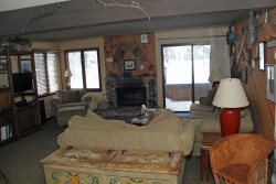 Mammoth Condo Rental Wildflower 7 - Living Room with Woodstove and Outside Deck
