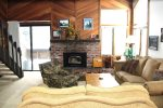 Mammoth Lakes Vacation Rental Wildflower 18 - Living Room Towards Woodstove and Outside Balcony