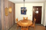 Mammoth Lakes Vacaiton Rental Chamonix A7 - Front Door and Cozy Dining Area with Seating for Four