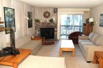 Mammoth Condo Rental Chamonix 45 - LR with Fireplace and Outside Deck Access