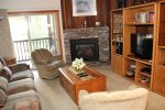 Mammoth Condo Rental Chamonix 40 - Living Room with Gas Fireplace and Outside Deck Access