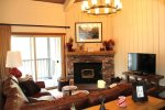 Mammoth Condo Rental Chamonix 60 - Cozy Living Room has a Flat Screen TV and Wood-stove