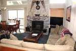 Mammoth Condo Rental Chamonix 99 - Living Room Has Large Flat Screen TV and Fireplace, Open Concept to Dining Room