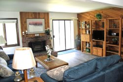 Mammoth Lakes Condo Rental Wildflower 45 - LR Features a Woodstove and Flat Screen TV