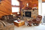 Mammoth Rental Snowflower 15 - Living Room has a Woodstove