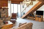 Mammoth Condo Rental  Snowflower 15 - Living Room has Outside Deck Access and a Spacious Vaulted Ceiling