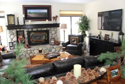 Mammoth Lakes Vacation Rental Silver Bear 37 Cozy Living Room with a Propane Fireplace and River Rock Hearth