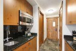 The kitchenette is equipped with a stove-top, microwave, dishwasher and refrigerator for your convenience