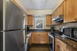 The well-equipped galley kitchen provides all the comforts of cooking in your own home