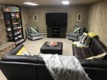 Entertainment area with 30 games/card games/board games, a PS4 with over 35 games, 65-inch TV and wraparound leather couch